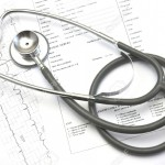 948625-Medical-still-life-with-Hospital-admission-paperwork-and-a-Doctor-s-stethoscope--Stock-Photo
